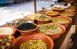 Different marinated olives and local food on spanish street mark Stock Images