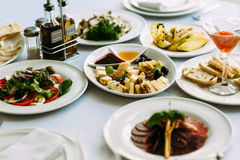 Different meals for the guests on the wedding table Stock Photo