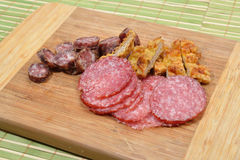 Different meat products (sausages, salami, breaded chicken breas Stock Photo