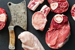 Different meats pork chicken fillet beef butcher knife black background top view. Set different meats pork, chicken fillet, beef with old vintage butcher knife stock photos