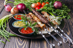 Different meats skewer Stock Photos