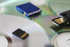 Different media storage. Sd card and pen Royalty Free Stock Images