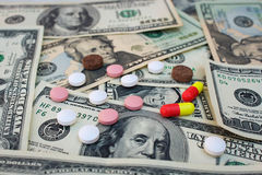 Different medical pills on the background of dollars Royalty Free Stock Photos
