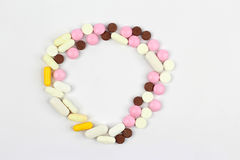 Different medical pills on white background in circle shape Royalty Free Stock Image
