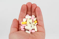 Different medical tablets in the palm of your hand Stock Image