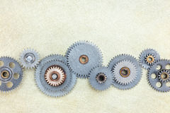 Different metal gear cogwheels on scratched brass background Royalty Free Stock Image