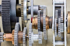Different metal mechanical industrial cogwheels closeup Royalty Free Stock Photo