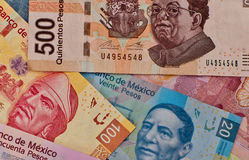 Different Mexican money background. Stock Photos