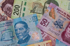 Different Mexican money background. Stock Photo