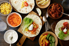 Different mexican street Tacos with ground meat and vegetables Stock Photos
