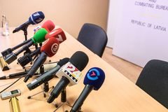 Different microphones on table, during press conference. stock photo