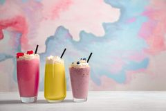 Different milkshakes in glasses on table royalty free stock image