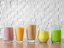 Different milkshakes in glassware royalty free stock photography