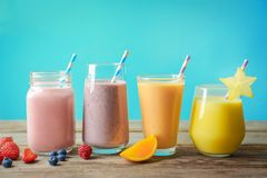 Different milkshakes in glassware royalty free stock images