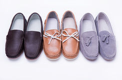 Different moccasins for a boy Royalty Free Stock Images