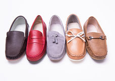Different moccasins for a boy Royalty Free Stock Photo