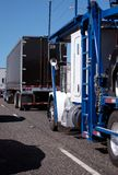 Different model and tapes of big rigs with dry van trailer and c Royalty Free Stock Photography