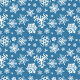 Different modern snowflakes on blue background Stock Photo
