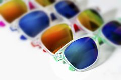 Different modern sunglasses close up isolated on a white background Royalty Free Stock Photos