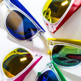 Different modern sunglasses close up isolated on a white background Royalty Free Stock Photography