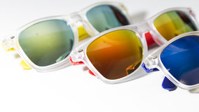 Different modern sunglasses close up isolated on a white background Royalty Free Stock Images