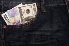 Different money in jeans pocket Stock Images