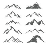 Different mountains. Set of different monochrome mountains, mountain icons, labels, badges, design elements. Vector Stock Photography