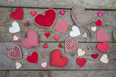 Different multicolored hearts of pink, red, white fabric and wood Stock Image