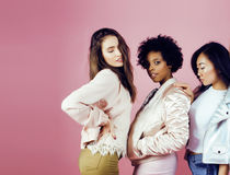 Different nation girls with diversuty in skin, hair. Asian, scandinavian, african american cheerful emotional posing on Stock Images