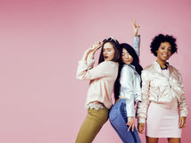 Different nation girls with diversuty in skin, hair. Asian, scandinavian, african american cheerful emotional posing on Royalty Free Stock Photo