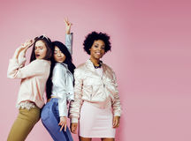 Different nation girls with diversuty in skin, hair. Asian, scandinavian, african american cheerful emotional posing on. Pink background, women day celebration Stock Images