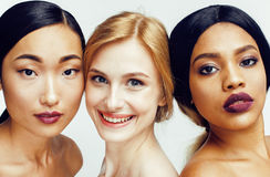 Different nation woman: asian, african-american, caucasian together isolated on white background happy smiling, diverse Stock Photos