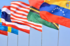 Different National flags. Different countries national flags getting together under blue sky, shown as worldwide, country, and international communication or Royalty Free Stock Photos