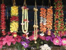 Different necklaces and artificial flowers Stock Photography