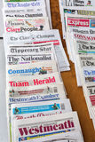 Different daily newspapers from England at a kiosk in London Royalty Free Stock Images
