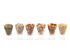 Different nuts. Cocktail of different nuts in short glasses, shot on white Stock Images