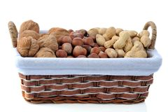 Different nuts in basket Royalty Free Stock Photography