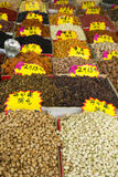 Different nuts and dried fruits on open asian market Royalty Free Stock Images