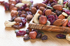 Different nuts,dry fruits and berries Stock Photo