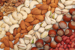 Different nuts lie strips Stock Photo