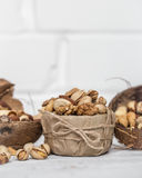 Different nuts in a plate closeup Royalty Free Stock Photo