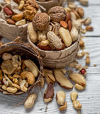 Different nuts in a plate closeup Stock Photos
