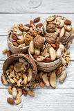 Different nuts in a plate closeup Royalty Free Stock Photos