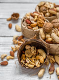 Different nuts in a plate closeup stock images