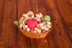 Different nuts with red heart Stock Images