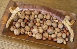 Different nuts in a wooden bowl royalty free stock photography