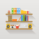 Different objects on book shelves Stock Photo