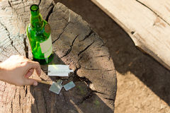 Different objects, symbols of addictive habits. High angle close-up of different objects, symbols of addictive habits: a syringe, a bottle of wine, a lighter and Royalty Free Stock Photography