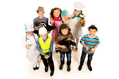 Different occupations. A group of children dressed in costumes of different professions. Isolated over white Royalty Free Stock Images