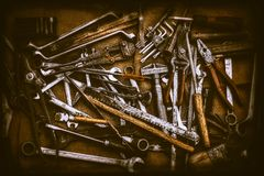 Different old kinds of tools and keys on jute bag. Top view royalty free stock images